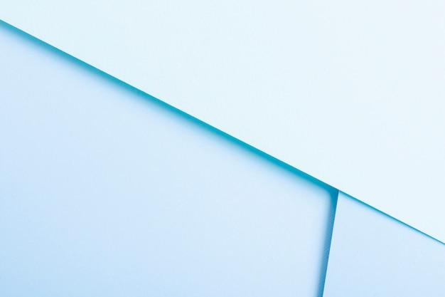 Blauwe getinte verzameling vellen papier met kopie ruimte Gratis Foto