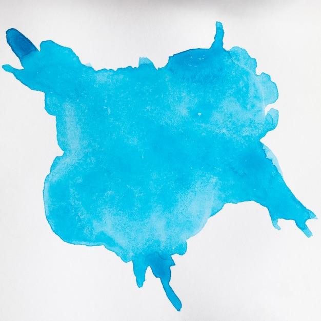 Blauwe handgeschilderde vlek op wit oppervlak Gratis Foto