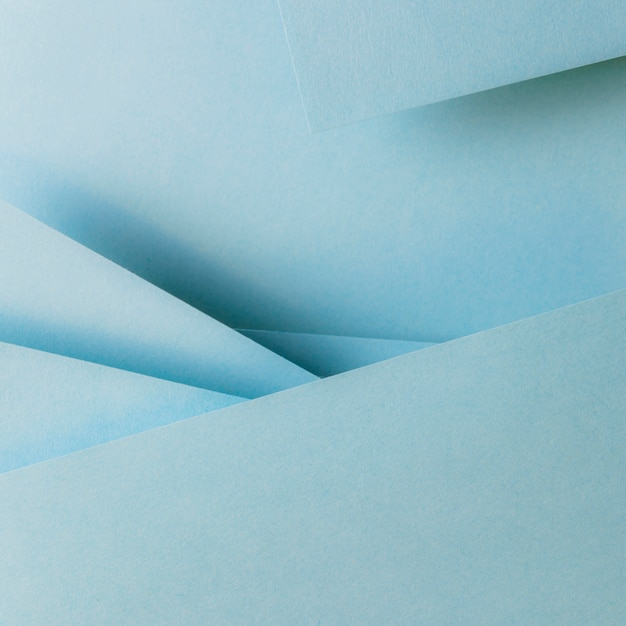 Blauwe kleur papieren geometrie samenstelling banner achtergrond Gratis Foto