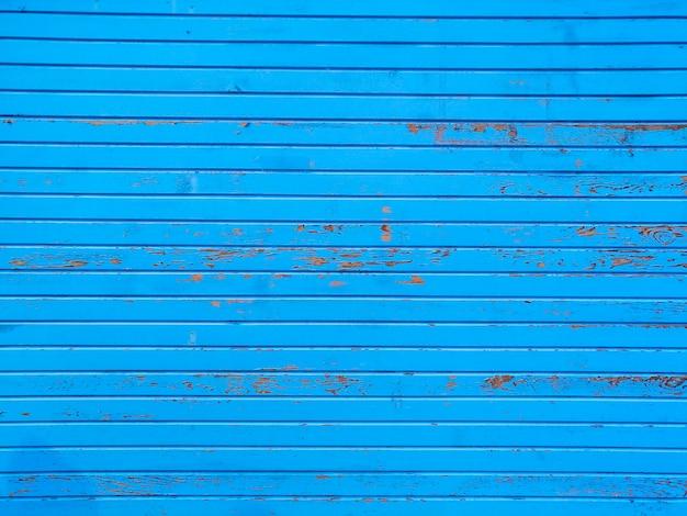 Blauwe muur met strepen Gratis Foto