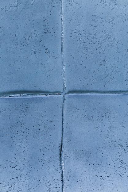 Blauwe muurverbinding met ruwe textuur Gratis Foto