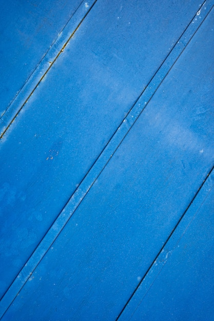 Blauwe roestige grunge metalen achtergrond of textuur met krassen en scheuren Gratis Foto