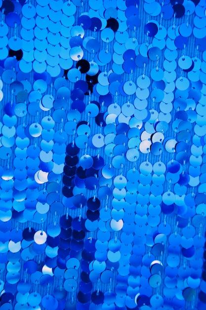 Blauwe ronde pailletten in modejurk Premium Foto
