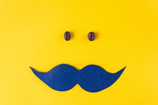 Blauwe snor en korrels van koffie voor movemberconcept Premium Foto