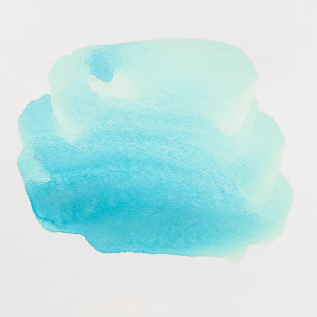 Blauwe waterverfpenseelstreek die op witte achtergrond wordt geïsoleerd Gratis Foto