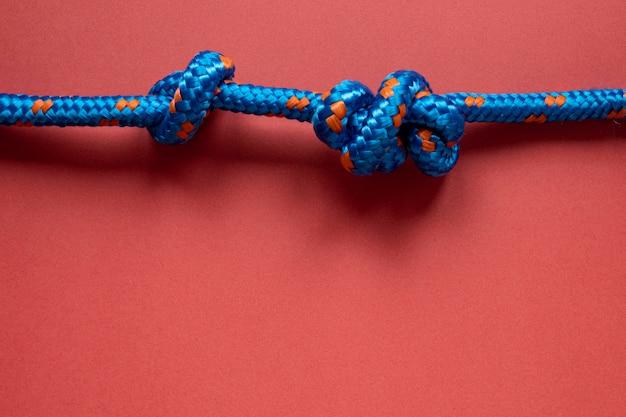 Blauwe zeeman touw knoop kopie ruimte Gratis Foto