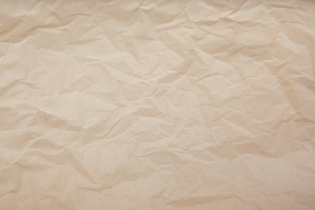 Bleke bruine verfrommelde document textuurachtergrond. Premium Foto