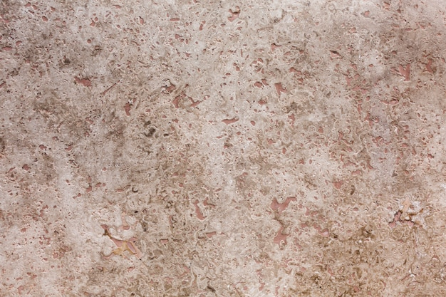 Bleke ruwe stenen achtergrond Gratis Foto