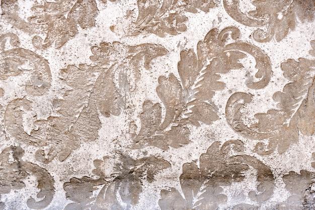 Bloemmotief als achtergrond gegraveerd in steen. Premium Foto