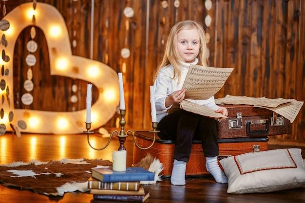 Blond meisje met scores Premium Foto
