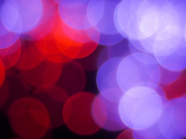 Bokeh abstracte achtergrond met rode en paarse zeepbel lichte kleur Premium Foto