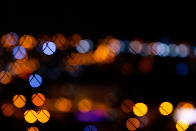 Bokeh stadslichten op zwarte achtergrond Premium Foto