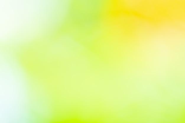 Bokehachtergrond met natuurlijk licht, groen, geel met vaag Premium Foto
