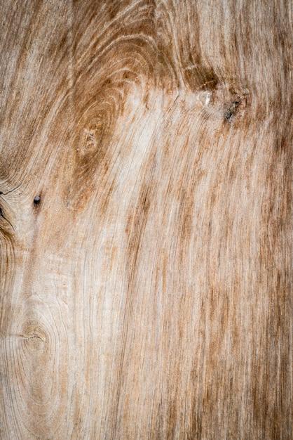 Boom knoop op een verticale houten plank in de buurt Gratis Foto