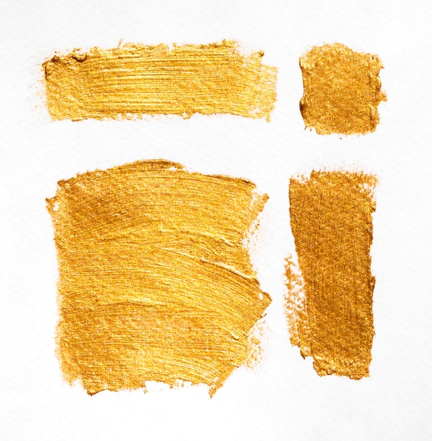Borstel met deeltjes van goud textuur verschillende vormen Gratis Foto