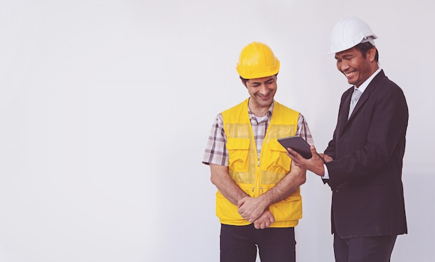 Bouw manager en ingenieur praten Premium Foto