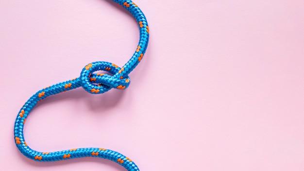 Bovenaanzicht blauw touw met knoop kopie ruimte Gratis Foto