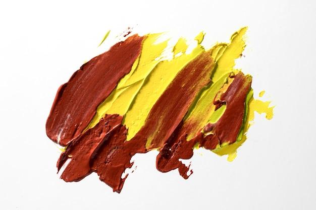 Bovenaanzicht bruine en gele penseelstreek Gratis Foto