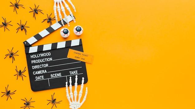 Bovenaanzicht filmklapper en spinnen met kopie ruimte Gratis Foto