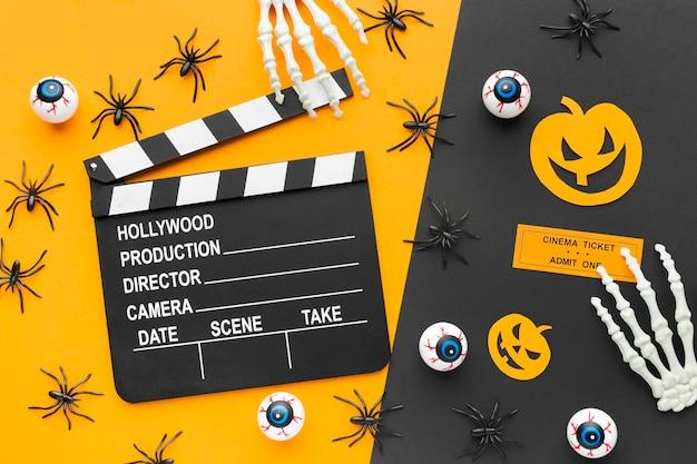 Bovenaanzicht filmklapper voor halloween-concept Gratis Foto