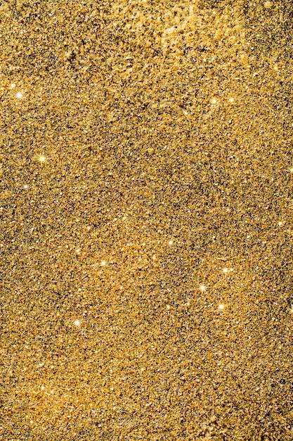 Bovenaanzicht gouden glitter achtergrond Gratis Foto