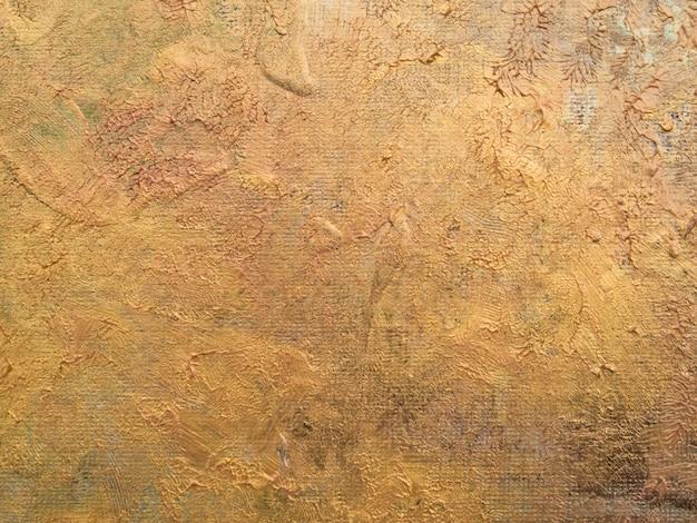 Bovenaanzicht gouden kleuren op canvas Gratis Foto