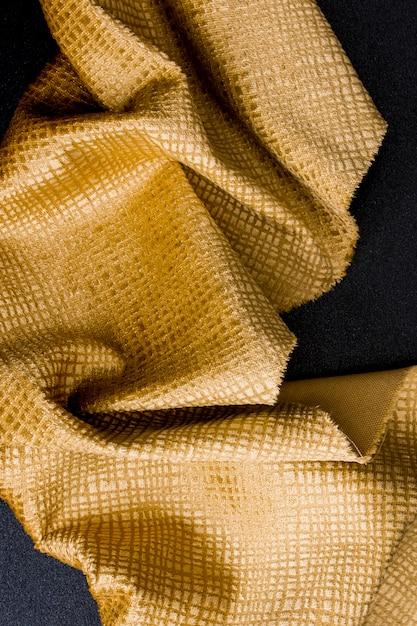 Bovenaanzicht gouden stof textuur Gratis Foto