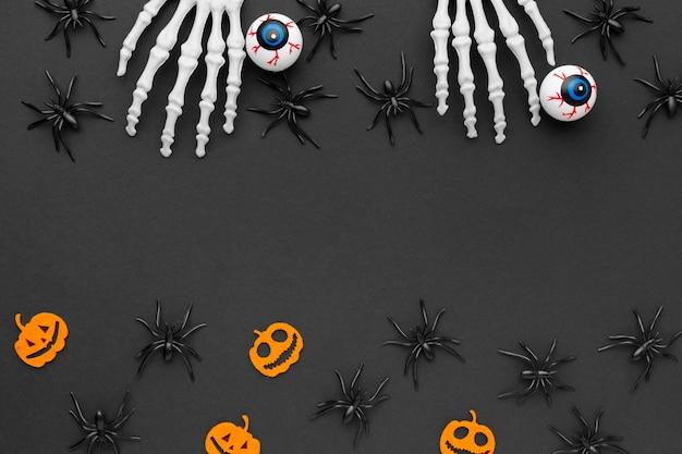 Bovenaanzicht halloween concept met spinnen Gratis Foto