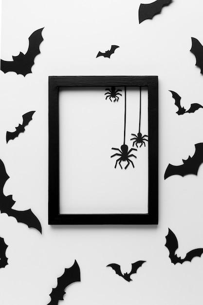 Bovenaanzicht halloween frame met spinnen Gratis Foto