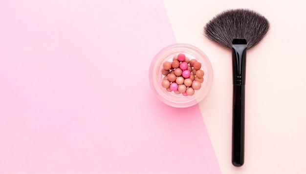 Bovenaanzicht make-up borstel met kopie ruimte Gratis Foto