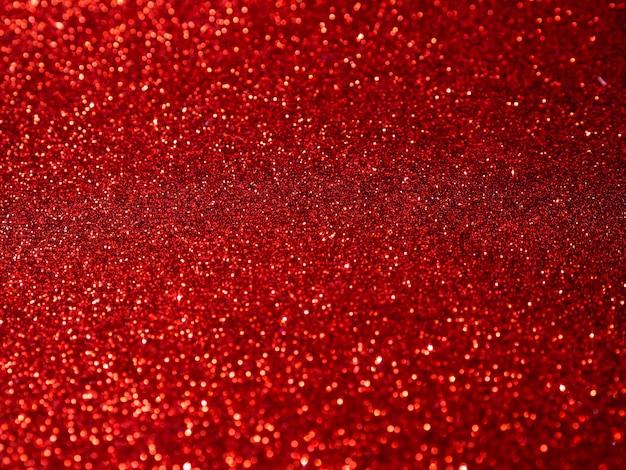 Bovenaanzicht rode glitter achtergrond Gratis Foto