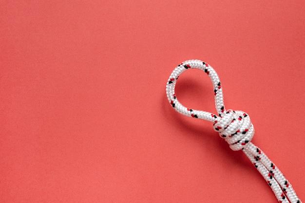 Bovenaanzicht touw met knoop kopie ruimte Gratis Foto