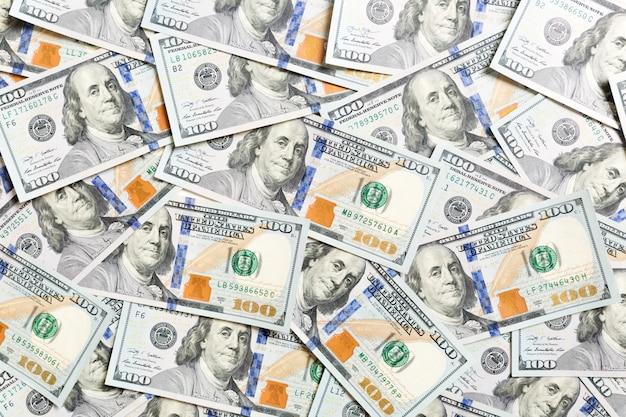 Bovenaanzicht van amerikaans geld. stapel dollar contant geld. papieren bankbiljetten Premium Foto