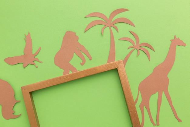 Bovenaanzicht van frame met papieren dieren voor dierendag Gratis Foto