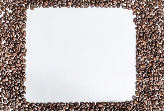 Bovenaanzicht van koffiebonen met kopie ruimte Gratis Foto