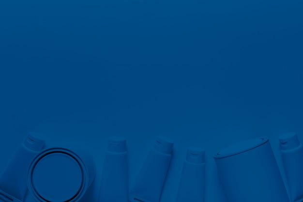 Bovenaanzicht verfblik en containers op klassieke blauwe kleur Gratis Foto