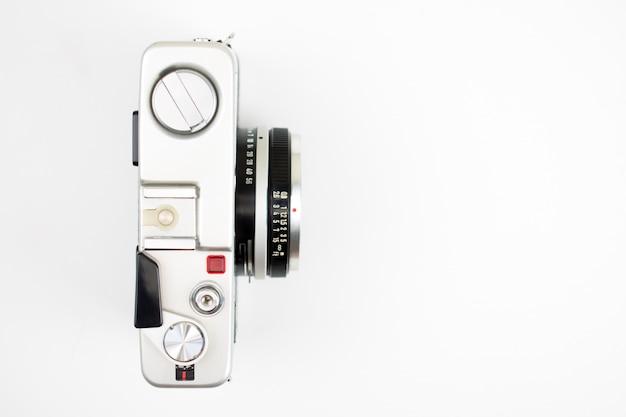 Bovenaanzicht, vintage camera op een witte achtergrond Premium Foto