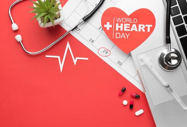 Bovenaanzicht wereld hart dag concept met stethoscoop Premium Foto