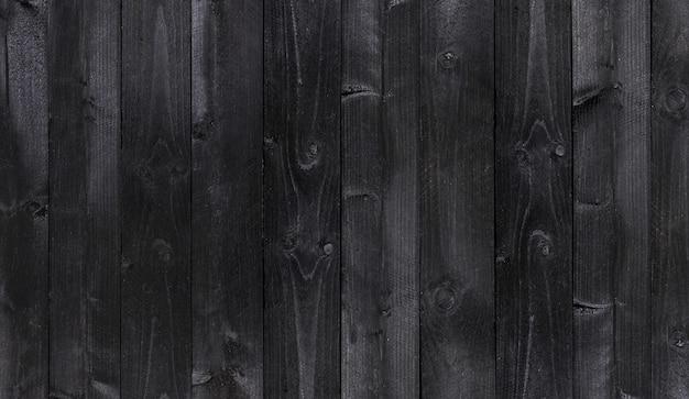 Brede zwarte houten achtergrond, oude houten planken textuur Premium Foto