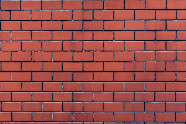 Brick wall orange wallpaper patter Gratis Foto