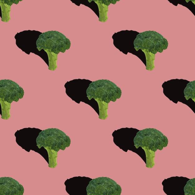 Broccoli naadloze patroon op rood Premium Foto