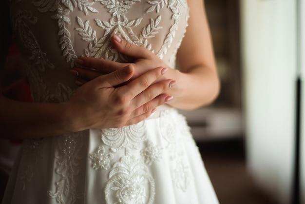 Bruid bruiloft details - bruiloft witte jurk voor een vrouw Premium Foto