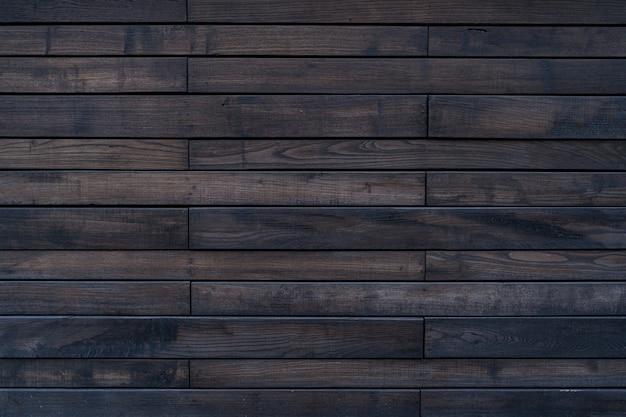 Bruin geschilderd houtstructuur van houten muur voor achtergrond en textuur. Gratis Foto