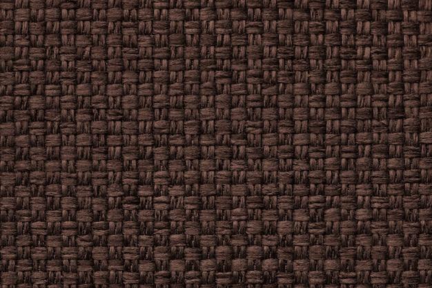 Bruine achtergrond met geruit patroon, close-up. structuur van de stoffenmacro. Premium Foto