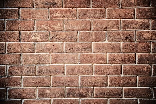 Bruine bakstenen muurachtergrond Gratis Foto