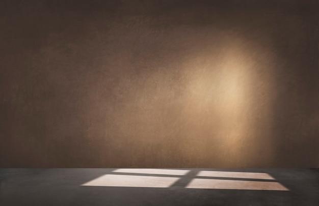 Bruine muur in een lege ruimte met concrete vloer Gratis Foto