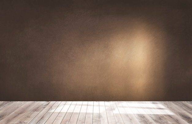 Bruine muur in een lege ruimte met een houten vloer Gratis Foto
