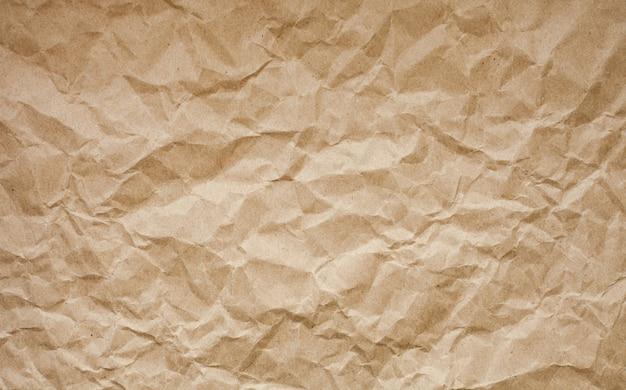 Bruine verfrommelde document achtergrond. Premium Foto