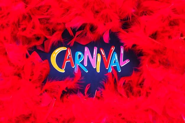Carnaval schrijven met veren frame Gratis Foto