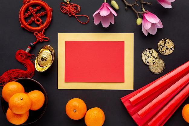 Chinees nieuwjaarskaartmodel met mandarijnen en magnolia Gratis Foto